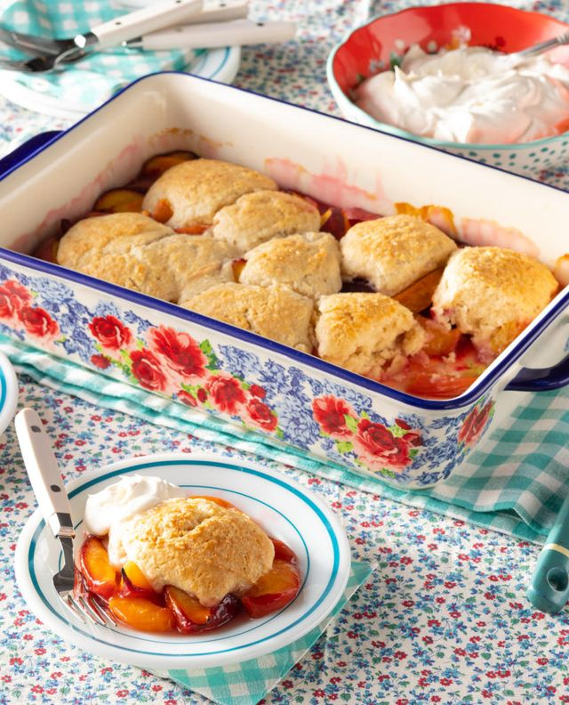 peach cobbler in pw casserole with whipped cream