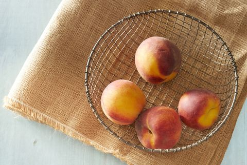 peaches in wire basket