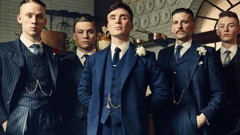 portrait of peaky blinders male brothers in wedding suit