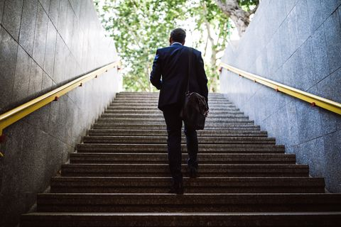 Pedestrian Businessman Walking Out Of Metro