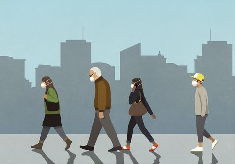 pedestrians in flu masks walking in city