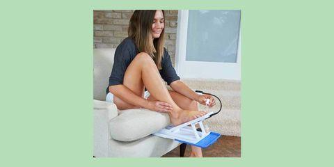 Leg, Sitting, Skin, Human leg, Arm, Thigh, Footwear, Hand, Furniture, Foot,