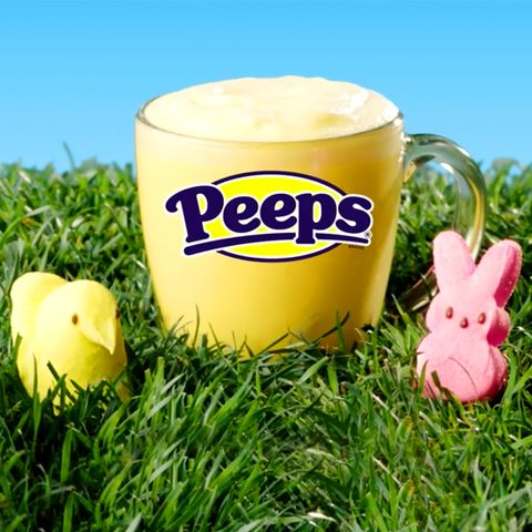 yellow peeps latte from 7 elevensitting in grass surrounded by peeps