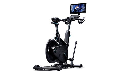 Exercise machine, Exercise equipment, Bicycle trainer, Elliptical trainer, Sports equipment, Stationary bicycle, Vehicle, Bicycle accessory, Wheel, Indoor cycling,