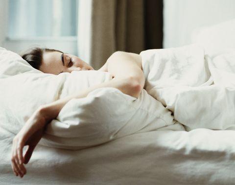 Skin, Beauty, Bed sheet, Child, Bed, Comfort, Bedding, Furniture, Room, Textile,