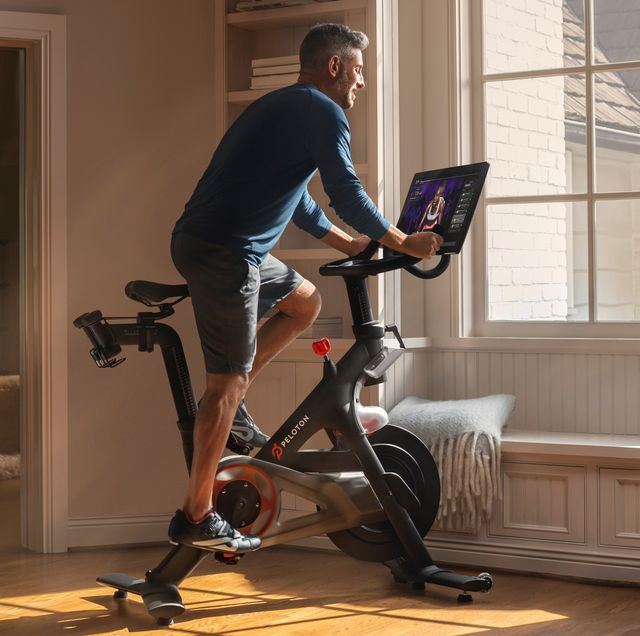 couple using peloton indoor cycling bike