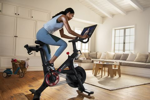 Stationary bicycle, Exercise machine, Indoor cycling, Exercise equipment, Vehicle, Sports equipment, Bicycle trainer, Room, Elliptical trainer, Sports,