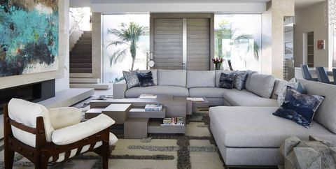 Living room, Furniture, Room, Interior design, Property, Couch, Coffee table, Building, Home, Table,