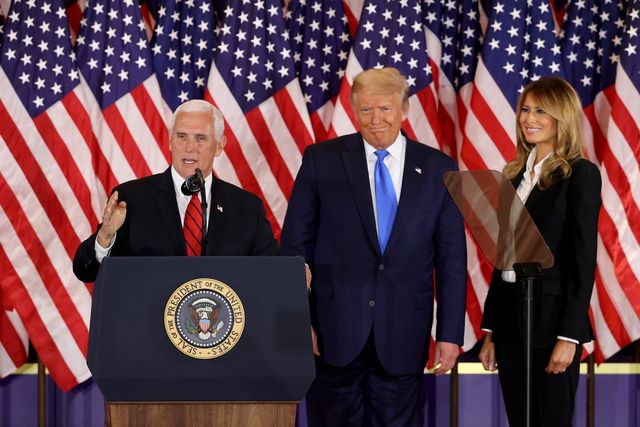 washington, dc   november 04 vice president mike pence speaks as us president donald trump and first lady melania trump watch on election night in the east room of the white house in the early morning hours of november 04, 2020 in washington, dc trump spoke shortly after 2am with the presidential race against democratic presidential nominee joe biden still too close to call photo by chip somodevillagetty images