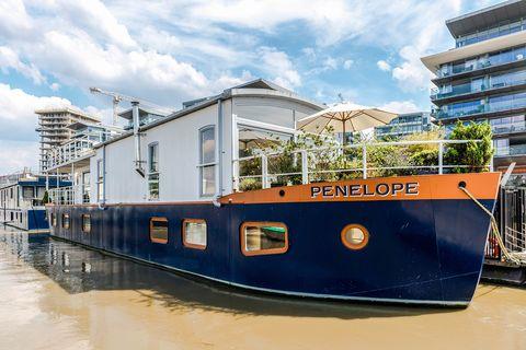 Buy a Thameside houseboat moored near Putney