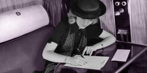 Reading, Black-and-white, Headgear, Hat, Monochrome photography, Monochrome, Photography, Fashion accessory, Sitting, Style,
