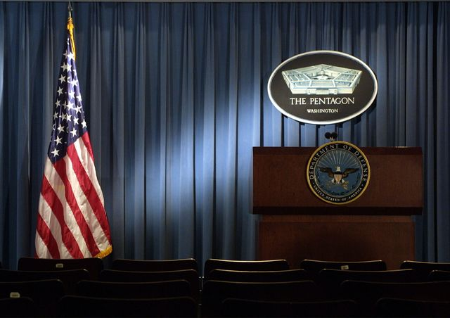 399192 06 the pentagon logo and an american flag are lit up january 3, 2002 in the briefing room of pentagon in arlington, va photo by alex wonggetty images