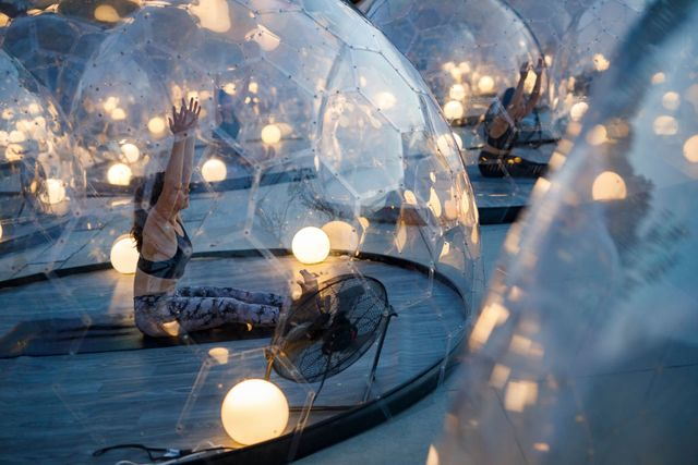 yoga class in toronto held outdoors in bubble pods