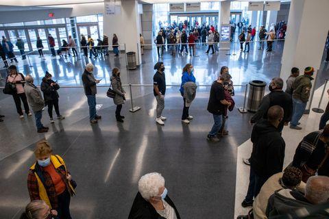 people wait to receive a coronavirus disease covid 19