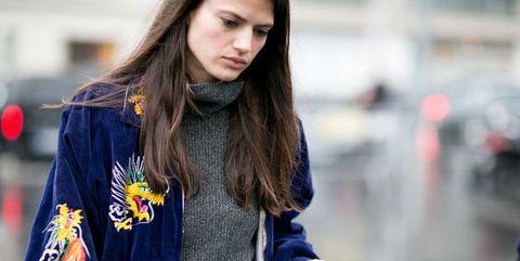 Sleeve, Textile, Street fashion, Jacket, Long hair, Brown hair, Fashion model, Model, Sweater, Top,