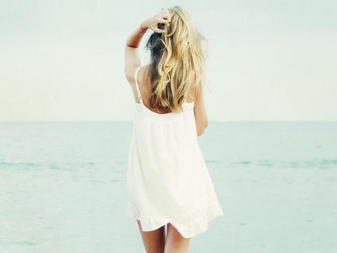 Hairstyle, Human body, Shoulder, Elbow, Standing, People on beach, Summer, People in nature, Ocean, Dress,