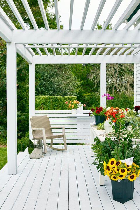 pergola over patio with flowers