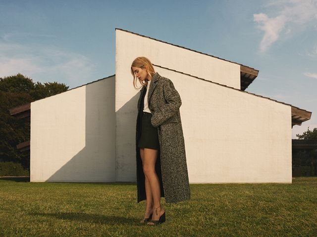 pernille teisbaek models clothing from her collaboration with mango in front of a house