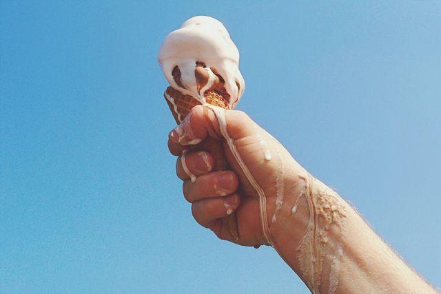person holding melting ice cream