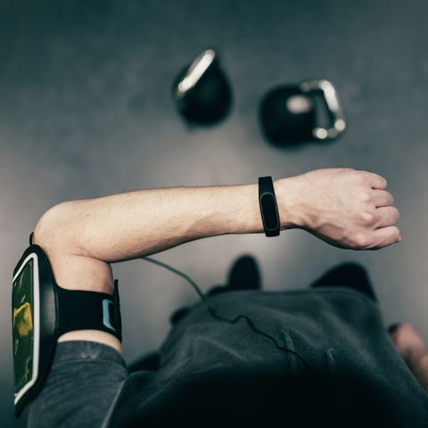 Personal perspective of man looking at smart watch