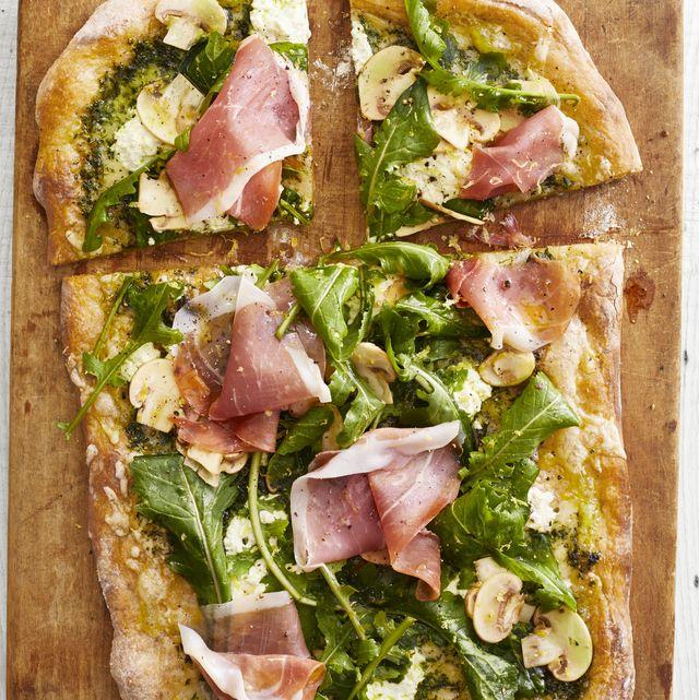 pesto pizza with arugula and prosciutto