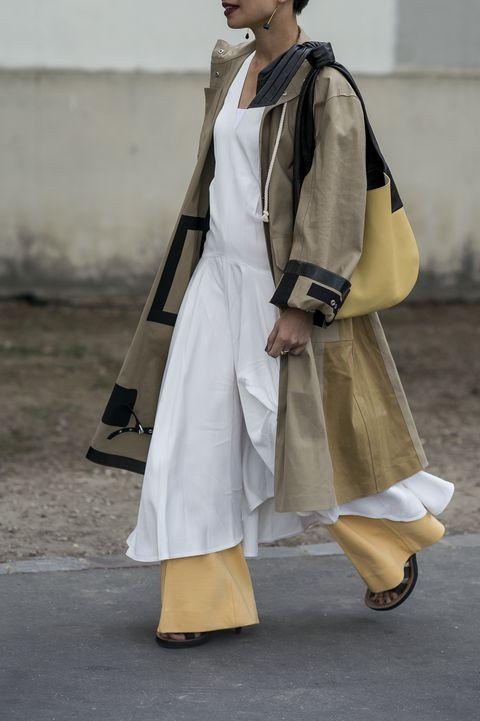 Outerwear, Street fashion, Bag, Dress, Fashion, Costume design, Beige, Luggage and bags, Sandal, Fashion design,