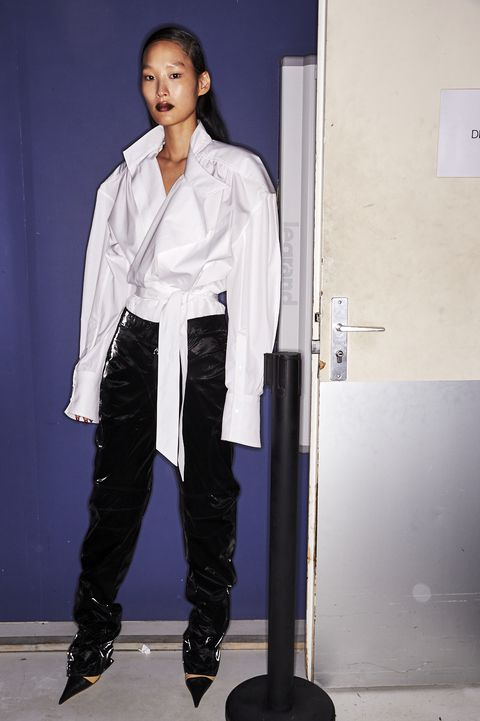 Standing, Fashion, Outerwear, Footwear, Uniform, Fashion design, Formal wear,