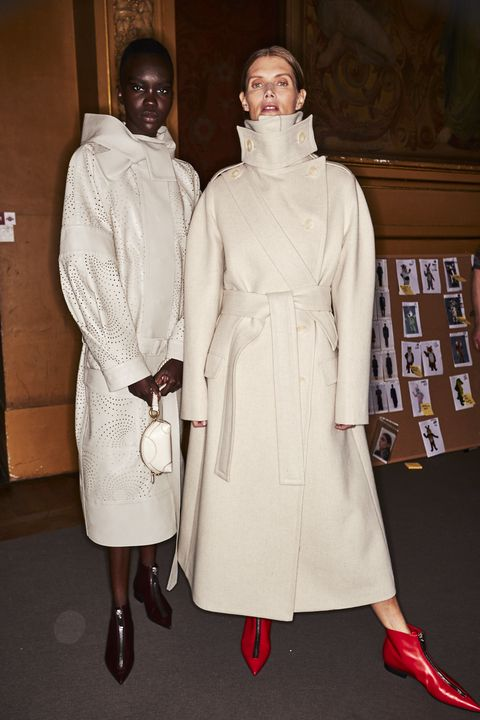 White, Clothing, Fashion, Outerwear, Trench coat, Coat, Fashion design, Dress, Overcoat, Costume,