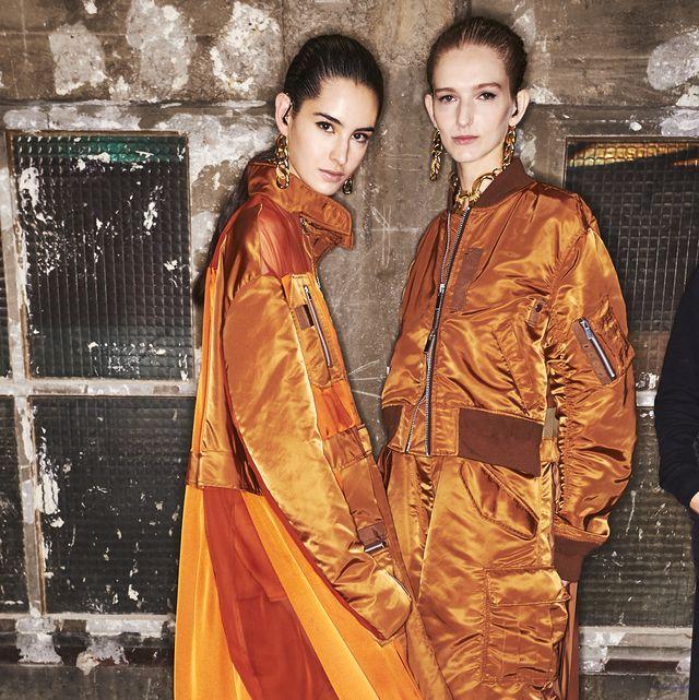 Clothing, Sari, Orange, Fashion model, Fashion, Yellow, Fashion design, Formal wear, Silk, Outerwear,