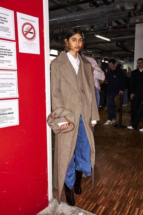 Clothing, Suit, Fashion, Formal wear, Outerwear, Blazer, Human, Fashion design, Coat, Event,