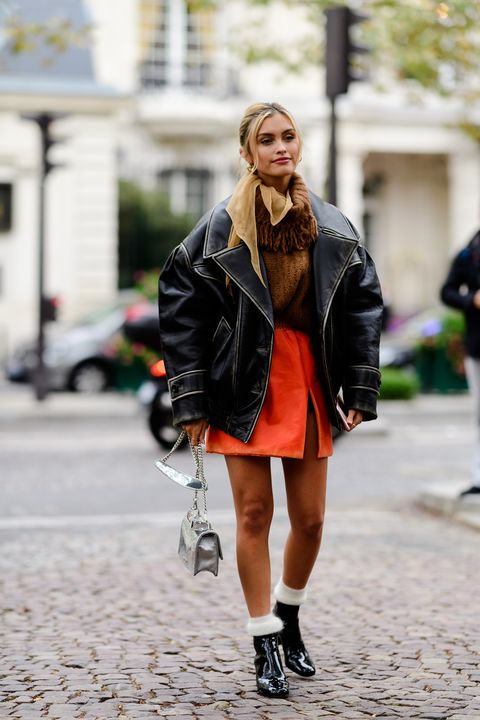 Clothing, Street fashion, Photograph, Fashion, Black, Leather, Street, Snapshot, Footwear, Outerwear,