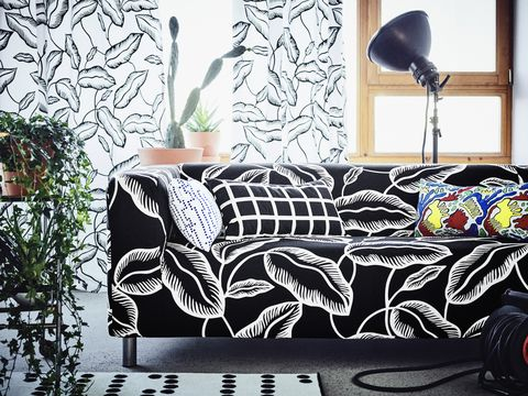 Black, Furniture, Living room, Couch, Room, Interior design, Wall, Black-and-white, Design, Table,