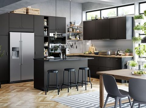 black and wood kitchen with seating