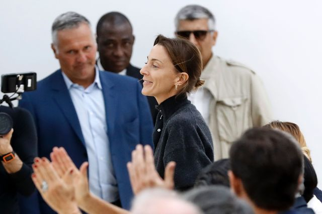 fashion designer for céline, phoebe philo c, acknowledges the audience at the end of her 2017 springsummer ready to wear collection fashion show, on october 2, 2016 in paris  afp  patrick kovarik        photo credit should read patrick kovarikafp via getty images