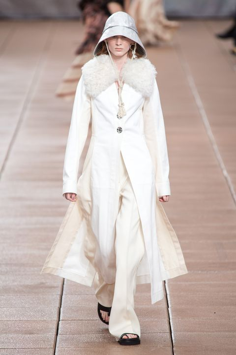 Fashion model, Fashion, White, Clothing, Runway, Fashion show, Haute couture, Coat, Outerwear, Street fashion,
