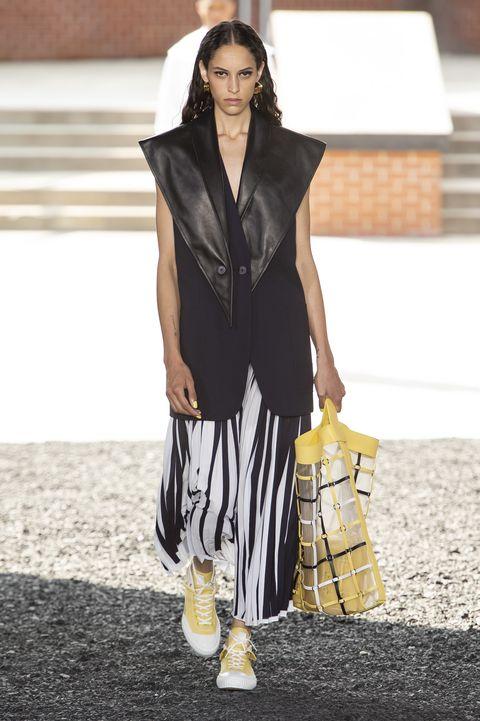 Clothing, Fashion, Fashion model, Street fashion, Fashion show, Runway, Outerwear, Footwear, Black-and-white, Fashion design,