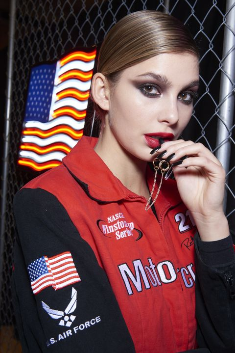 Lip, Sleeve, Eyebrow, Eyelash, Red, Flag, Logo, Beauty, Uniform, Eye liner,