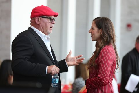 tampa, fl  april 10, 2019   head coach bruce arians of the tampa bay buccaneers and ownerpresident tampa bay buccaneers foundation and glazer family foundation darcie glazer kassewitz at the 2019 women of red luncheon in bar 76 at raymond james stadium in tampa, fl photo by kyle zedakertampa bay buccaneers