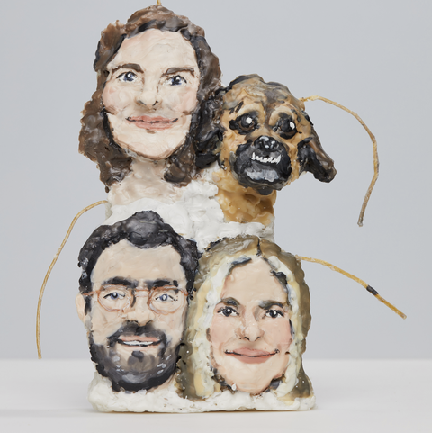 wax statues of people and dog
