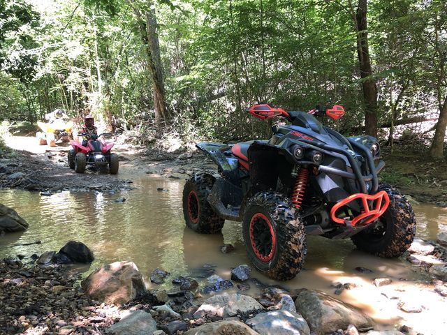 Automotive tire, Tread, Fender, All-terrain vehicle, Off-road vehicle, Synthetic rubber, Rim, Automotive wheel system, Off-roading, Stream,