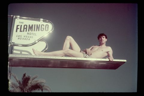 rock hudson lounging on a diving board