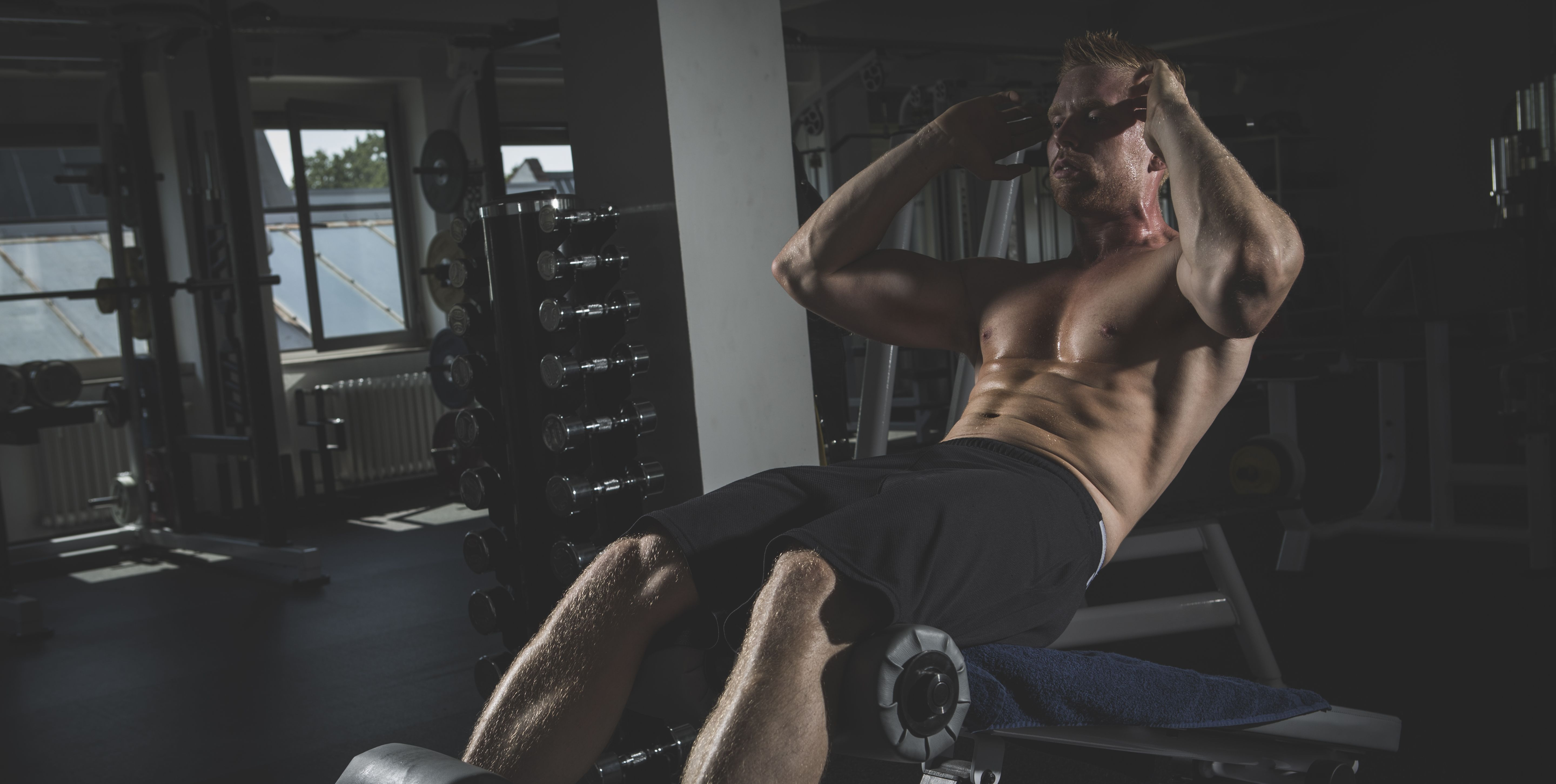 Physical athlete doing crunches