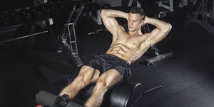 Athlete exercising his abswith glute ham developer