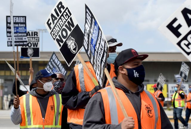 san pedro, ca   april 14 longshore workers briefly walked off the job on in solidarity with the teamsters to picket and disrupt traffic,  to one of pola's seven terminals in san pedro on wednesday, april 14, 2021 photo by brittany murraymedianews grouplong beach press telegram via getty images