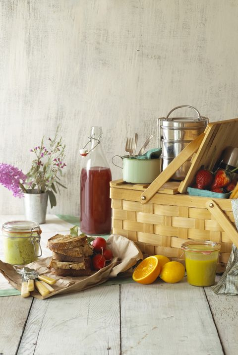 picnic basket with food and flowers