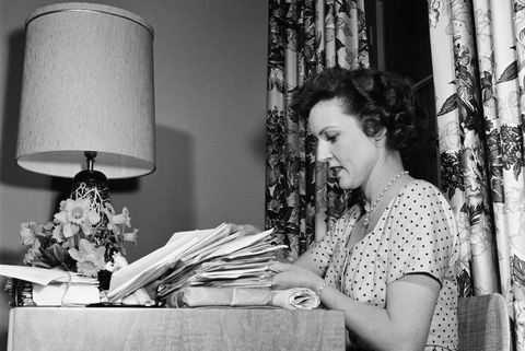 vintage photos of celebrities at home   betty white at a desk