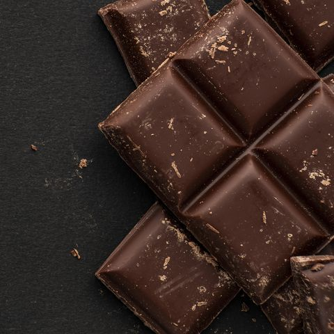 pieces of dark chocolate on black background