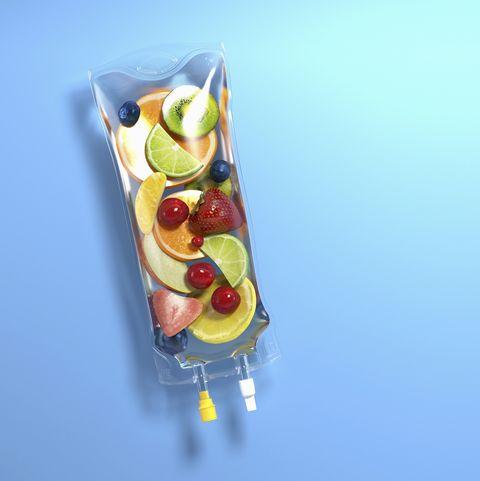 Pieces of fresh fruit inside of intravenous drip bag