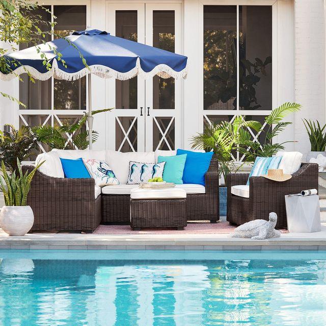 backyard with pool and patio set