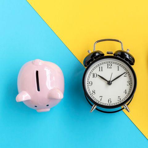 piggy bank, alarm clock and calculator